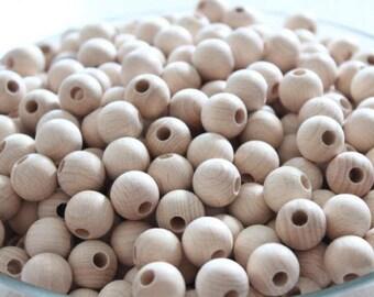 Set of 15 beads of beech wood raw 18mm
