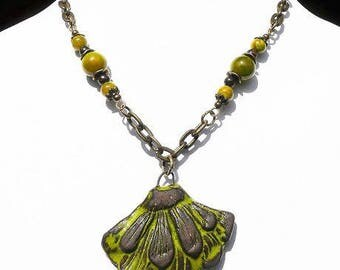 Necklace with a stylized leaf green and taupe ceramic