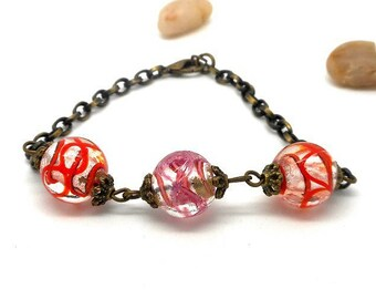 Bracelet beads bronze color transparent with red edging