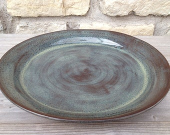 Pottery Dinner Plate on dark clay