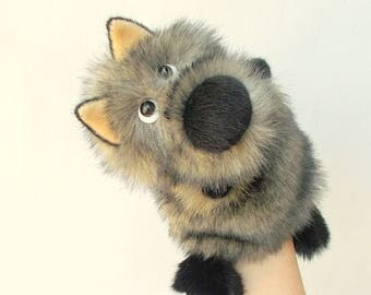 Little wolf. Bibabo. Toy glove. Toy on hand. Puppet theatre. Marionette.