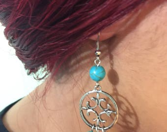 Turquoise and silver ornate drop earrings