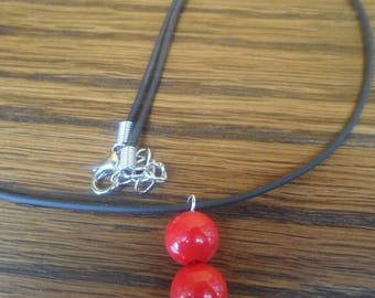 Necklace black leather and red beads