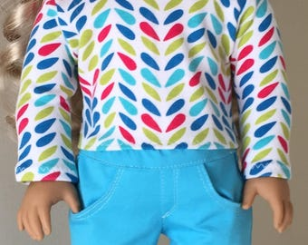 Fits American Girl doll:  multi-colored tee and turquoise skinny jeans