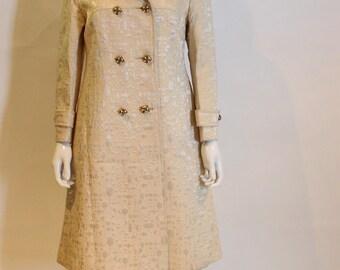 a vintage cream 1960s Brocade coat by Braunschweig of Switzerland M