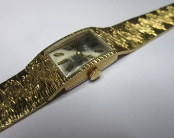 Watch Avila in a gold plated bracelet, mecanical 17 jewels incabloc Swiss made