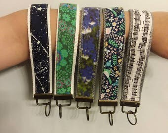 Ready to ship Wristlet Keychains white cotton canvas kaffe fassett music notes blue birds antiqued bronze keyring
