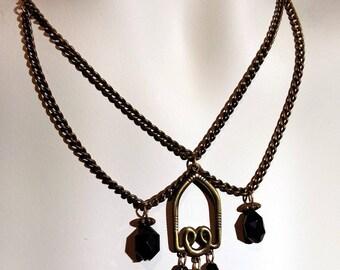 Vintage brass chain an black crystal brass center piece plated antique gokd