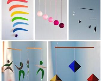Set of 5 Montessori Mobiles. Munari. Pink Gobbi. The Dancer Mobile. The octahedron Mobile. The Rainbow mobile. Classic montessori mobiles.