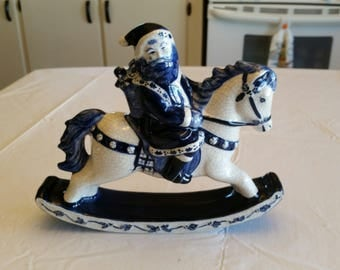 dedham pottery santa on rocking horse by potting shed signed art  limited edition retired figure christmas winter statue  ceramic blue white
