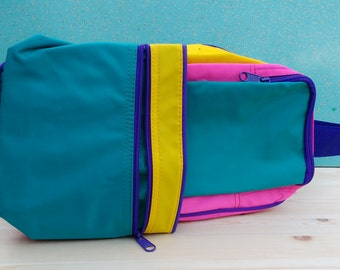 Killer colourful pink yellow teal purple zip up bag