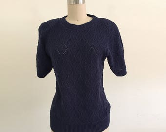 Navy Knit Sweater with Statement Shoulders and Ribbed Hems