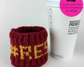Knitted #RESIST coffee sleeve