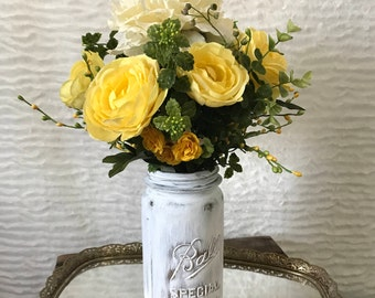 Artificial Flower Arrangement with Yellow Ranunculus, Off-White Peony, Small Yellow Roses, and Greenery Throughout