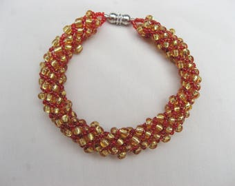 Russian Spiral Bracelet in Red and Gold Glass Beads with a Magnetic Clasp