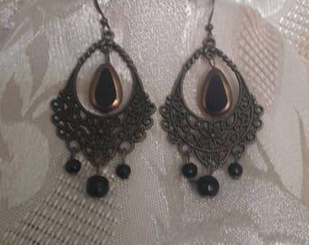 Bohemian dangle earrings with black beads