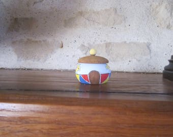 Rings, tooth, pill box miniature African hut box