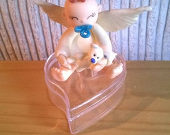 Figurine baby Angel boy on small heart box to hold some sweets made of cold porcelain