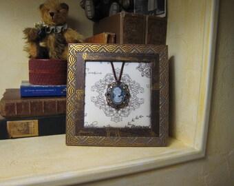 Cadre bijou médaillon camée décoration chic et raffinée