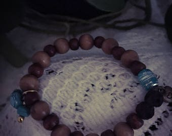 Handcrafted wooden bead stretch bracelet with blue accents