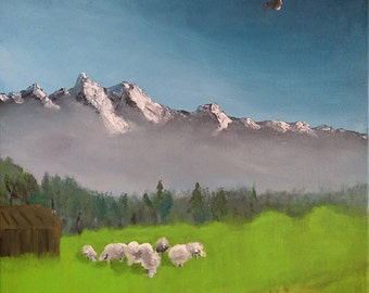 Mountain landscape with sheep in a pasture