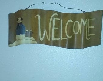 Rustic welcome sign with snowman for winter or christmas decorating