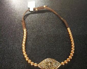 14kt Gold beaded bracelet with diamond-encrusted eye pattern 94points