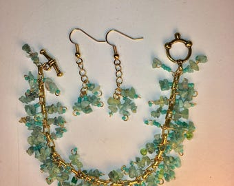 Gold tone and turquoise colored gemstone bracelet and matching earring set