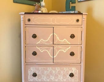 Sweet pink dresser and dollhouse fit for a princess with white rose lace detail