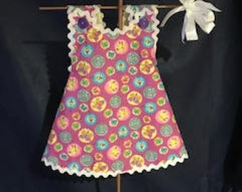 """Girl's spring sundress.  White rick rack trim and a big white bow for her hair.  Size Medium (16-18 lbs, 27""""-28"""" tall)"""