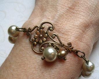 Pearl bracelet, vintage style, brass floral charm, taupe, elegant bracelet