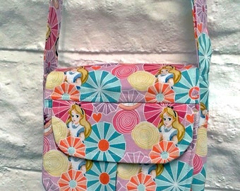 Small Messenger cross body purse made for the Sew Powerful Purse Project from yellow, pink and lilac fabric