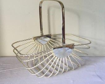 Vintage silver-plate basket - egg basket twisted basket with swing handle  handle lies flat - elegant hollywood regency