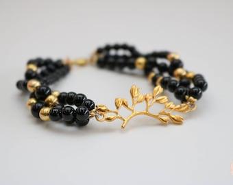 Cleopatra Gold and Black beaded bracelet.