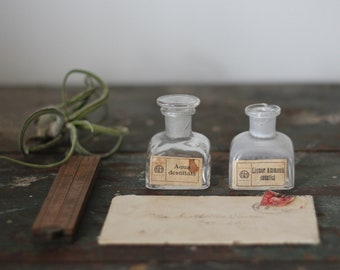 antique vintage apothecary glass bottles / small clear pharmacy jars / original latin labels