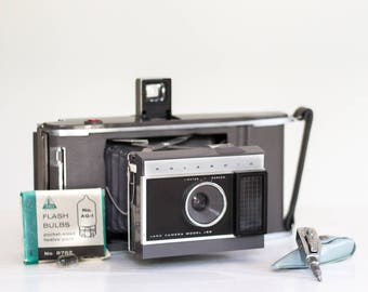 Vintage Polaroid Model J66 Land Camera With Original Case, Flash Bulbs, and Automatic Timer