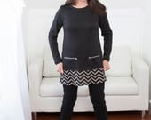 Sale - Black tunic top with chevron bottom and two zipper pockets.