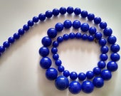 Funky Vintage 1970's Cobalt Blue Graduated Beaded Plastic Necklace 30 Inches Long