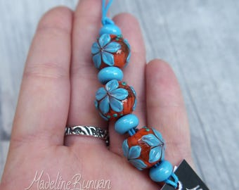 Orange and Turquoise bright flower rounds Lampwork bead set (3 plus 4 spacers) SRA