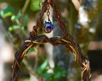 Twisted Cedar Root Bird Swing with Blue Marble