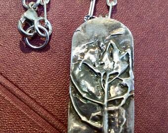 GARDEN CARNELIAN PENDANT Luscious rectangle of Rich Carnelian hinged below an arched garden flower pendant on sterling chain Pat Gullett