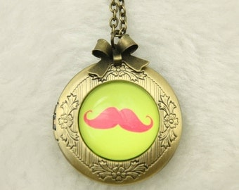 Necklace locket red mustache on a green background 2020m