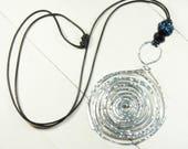 Hammered silver spiral ne...