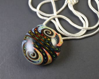 FREE SHIPPING - Hollow Glass Wig-wag Pendant, Black/Rainbow, fully worked