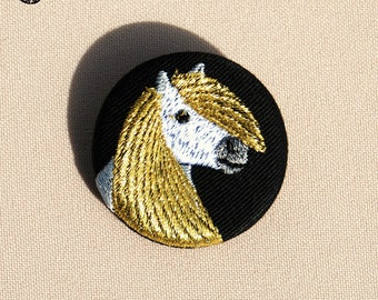 Small brooch with gold pony portrait