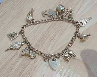 Vintage 9ct gold charm bracelet with 10 hallmarked charms
