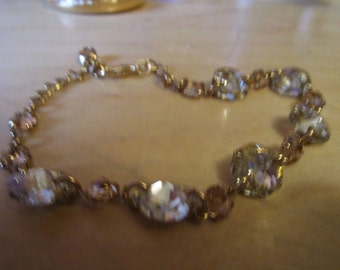 """vintage goldtone chain bracelet in great condition with round faceted stone links/smaller stone links 8""""adjustable"""