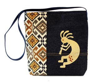 Kokopelli - Repurposed Denim Totebag.  Made of recycled denim, woven fabric and embroidery.  Eco-Friendly - unique.