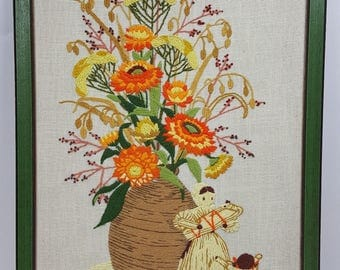 Vintage framed crewel embroidery picture corn husk doll family and fall flowers 15X23
