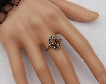 Vintage Art Deco Silver Ring with a fine cut Carnelian gem.       Unique design.